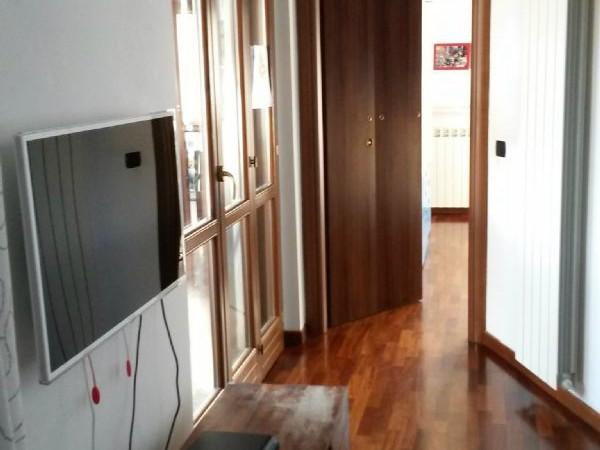 Appartamento in vendita a Caronno Pertusella, Arredato, con giardino, 55 mq