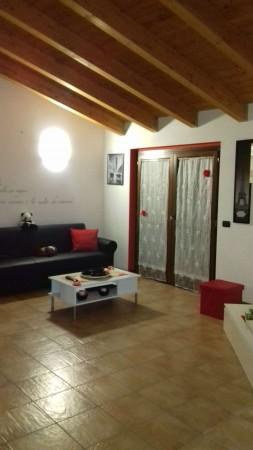 Appartamento in vendita a Caronno Pertusella, Arredato, 65 mq
