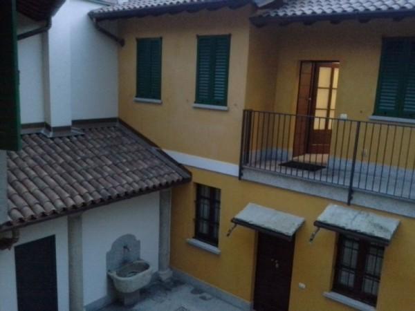 Appartamento in affitto a Magenta, Centrale, Con giardino, 60 mq
