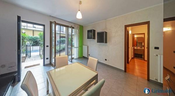 Appartamento in vendita a Garbagnate Milanese, Arredato, con giardino, 75 mq