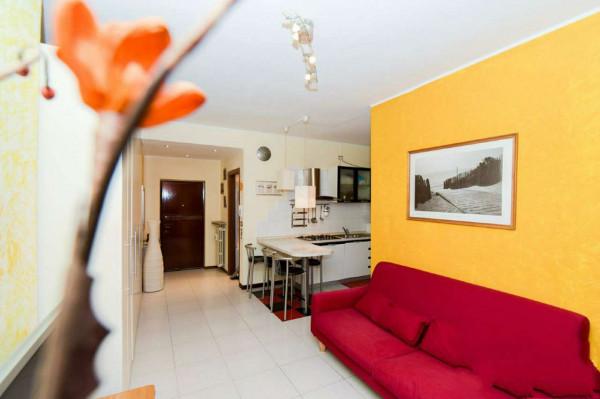 Appartamento in vendita a Garbagnate Milanese, Arredato, con giardino, 57 mq