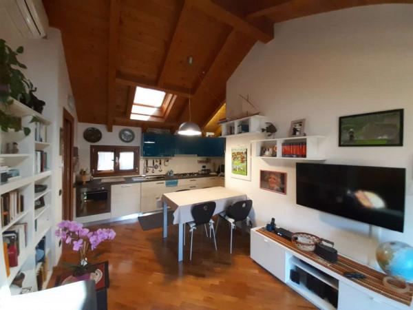Appartamento in vendita a Caronno Pertusella, Centro, 55 mq
