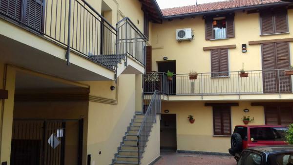 Appartamento in vendita a Caronno Pertusella, Centro, 60 mq